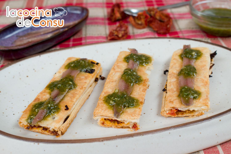 Hojaldre con tomates secos, anchoas y pesto de albahaca